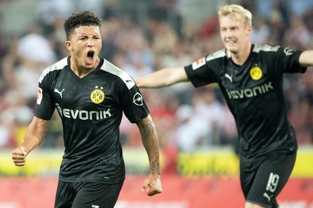 Dortmund's English midfielder Jadon Sancho inspired his team to 3-1 win against Cologne on Friday (AFP Photo/Federico Gambarini)