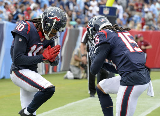 Houston Texans wide receiver DeAndre Hopkins celebrates with Will Fuller (15) after Hopkins scored a touchdown on a 28-yard play against the Tennessee Titans in the first half of an NFL football game Sunday, Sept. 16, 2018, in Nashville, Tenn. (AP Photo/Mark Zaleski)