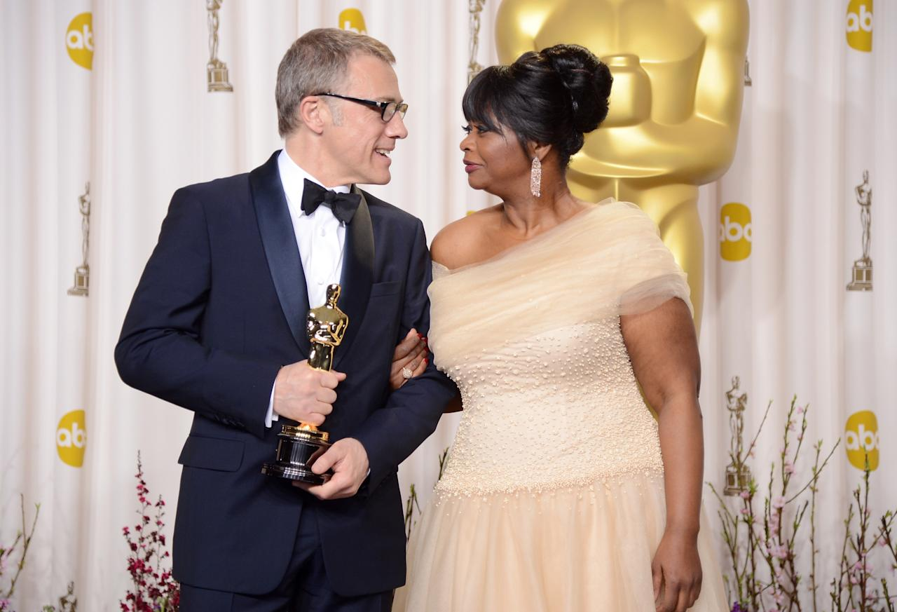 "HOLLYWOOD, CA - FEBRUARY 24:  Actor Christoph Waltz, winner of the Best Supporting Actor award for ""Django Unchained,"" and presenter Octavia Spencer pose in the press room during the Oscars held at Loews Hollywood Hotel on February 24, 2013 in Hollywood, California.  (Photo by Jason Merritt/Getty Images)"