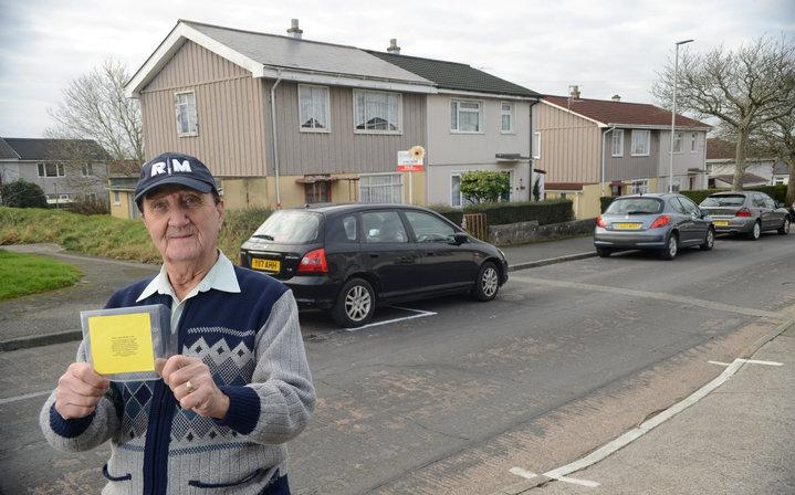 Not happy: Donald Ligertwood with his home made parking ticket (SWNS)