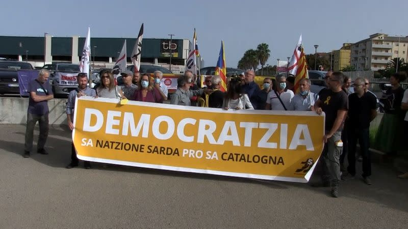Protesters gather outside Sardinia court in support of Catalan separatist leader