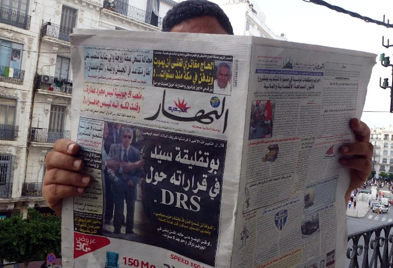 An Algerian man reads a local newspaper, En-Nahar, bearing a picture for the first time of former Algerian intelligence chief General Mohamed Mediene, better known as General Toufik, on the front cover in the capital, Algiers, on September 13, 2015