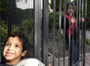"""Children play at a refugee center in Bialystok, Poland, on Wednesday, Sept. 29, 2021. After enduring a decade of war in Syria, Boshra al-Moallem and her two sisters seized their chance to flee, but the journey proved terrifying and nearly deadly. Al-Moallem, originally from Homs but who displaced to Damascus by the war, is one of thousands of people who have traveled to Belarus in recent weeks and then found herself helped to cross the border with the help of Belarusian guards, something the EU considers a form of """"hybrid war"""" waged against the bloc with the use of human lives. (AP Photo/Czarek Sokolowski)"""