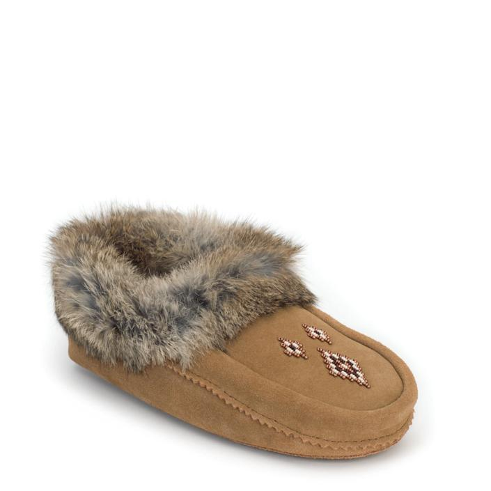 """Nothing says cold weather coziness like a warm pair of slippers, so grab Manitobah Mukluks&rsquo; top-selling moccasins so your host can get comfortable after a day of running around to please their guests. The Indigenous-owned company produces part of its footwear at its Indigenous-owned production facility in Winnipeg in Manitoba, Canada, and strives to celebrate those values and keep the culture alive through classes at its Manitobah Mukluks Storyboot School. Manitobah Mukluks&rsquo; <a href=""""https://www.manitobah.com/collections/storyboots#storyboot-section"""" rel=""""nofollow noopener"""" target=""""_blank"""" data-ylk=""""slk:Storyboot Project"""" class=""""link rapid-noclick-resp"""">Storyboot Project</a> collection gives 100 percent of its proceeds to the artists, a group of elders and artisans who craft mukluks and moccasins in the time-honored fashion.&lt;br&gt;&lt;br&gt;<strong><a href=""""https://www.manitobah.com/collections/moccasins/products/tipi?variant=348864161"""" rel=""""nofollow noopener"""" target=""""_blank"""" data-ylk=""""slk:Manitobah Mukluks Tipi Moccasins"""" class=""""link rapid-noclick-resp"""">Manitobah Mukluks Tipi Moccasins</a>, $69.99</strong>"""