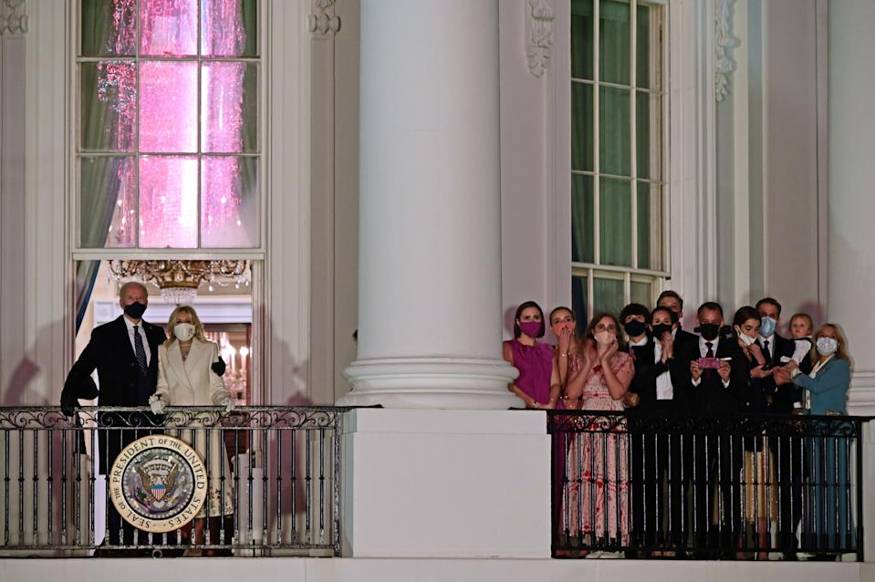 President Joe Biden, First Lady Jill Biden and the rest of their family watch the fireworks from separate balconies at the White House. (Photo: Getty Images)