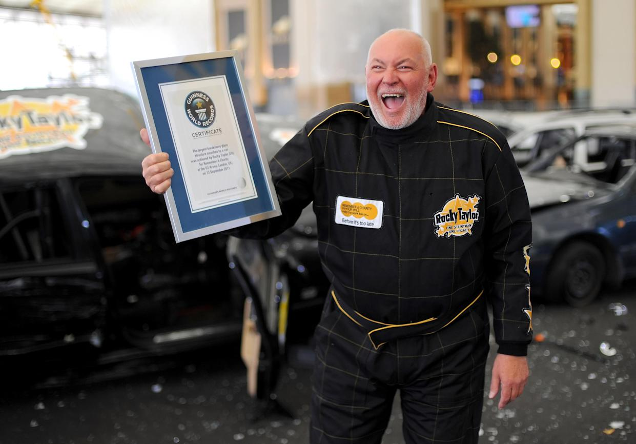 Hollywood stuntman Rocky Taylor, 64, after breaking the Guinness World Record for 'largest breakaway glass structure smashed by a car' at the O2 Arena, in Greenwich, London.   (Photo by Dominic Lipinski/PA Images via Getty Images)