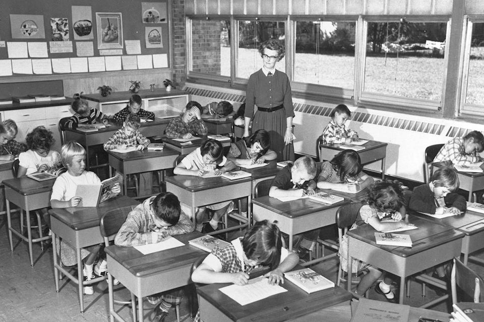<p>Students are hard at work while their teacher keeps a watchful eye.</p>