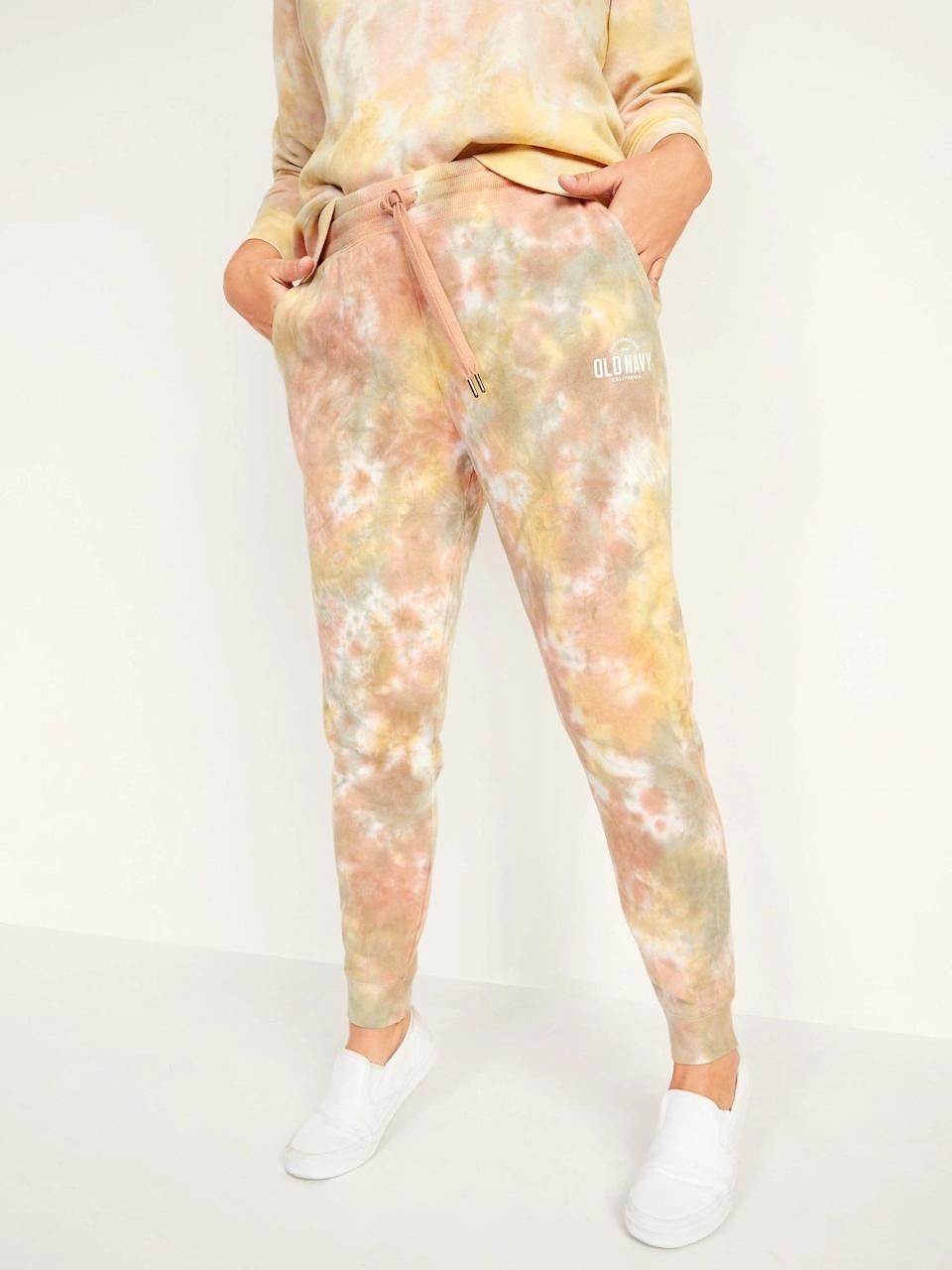 <p>These cuddly <span>Old Navy Mid-Rise Tie-Dyed Logo-Graphic Sweatpants</span> ($35) come complete with pockets. So cute!</p>