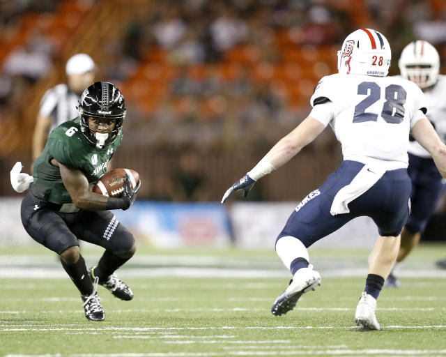 Hawaii wide receiver Cedric Byrd (6) looks to get away from Duquesne defensive back Spencer Demedal (28) during the second quarter of an NCAA college football game Saturday, Sept. 22, 2018, in Honolulu. (AP Photo/Marco Garcia)