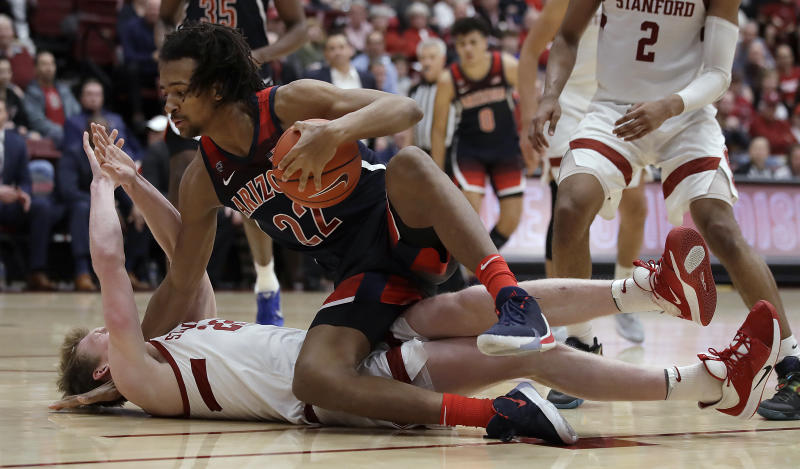Arizona's Zeke Nnaji (22) falls onto Stanford's James Keefe during the second half of an NCAA college basketball game Saturday, Feb. 15, 2020, in Stanford, Calif. (AP Photo/Ben Margot)