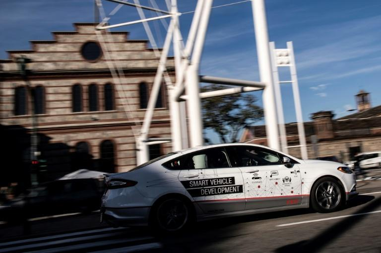 5G should facilitate the adoption of self-driving cars, like this one being tested in the northern Italian city of Turin in November