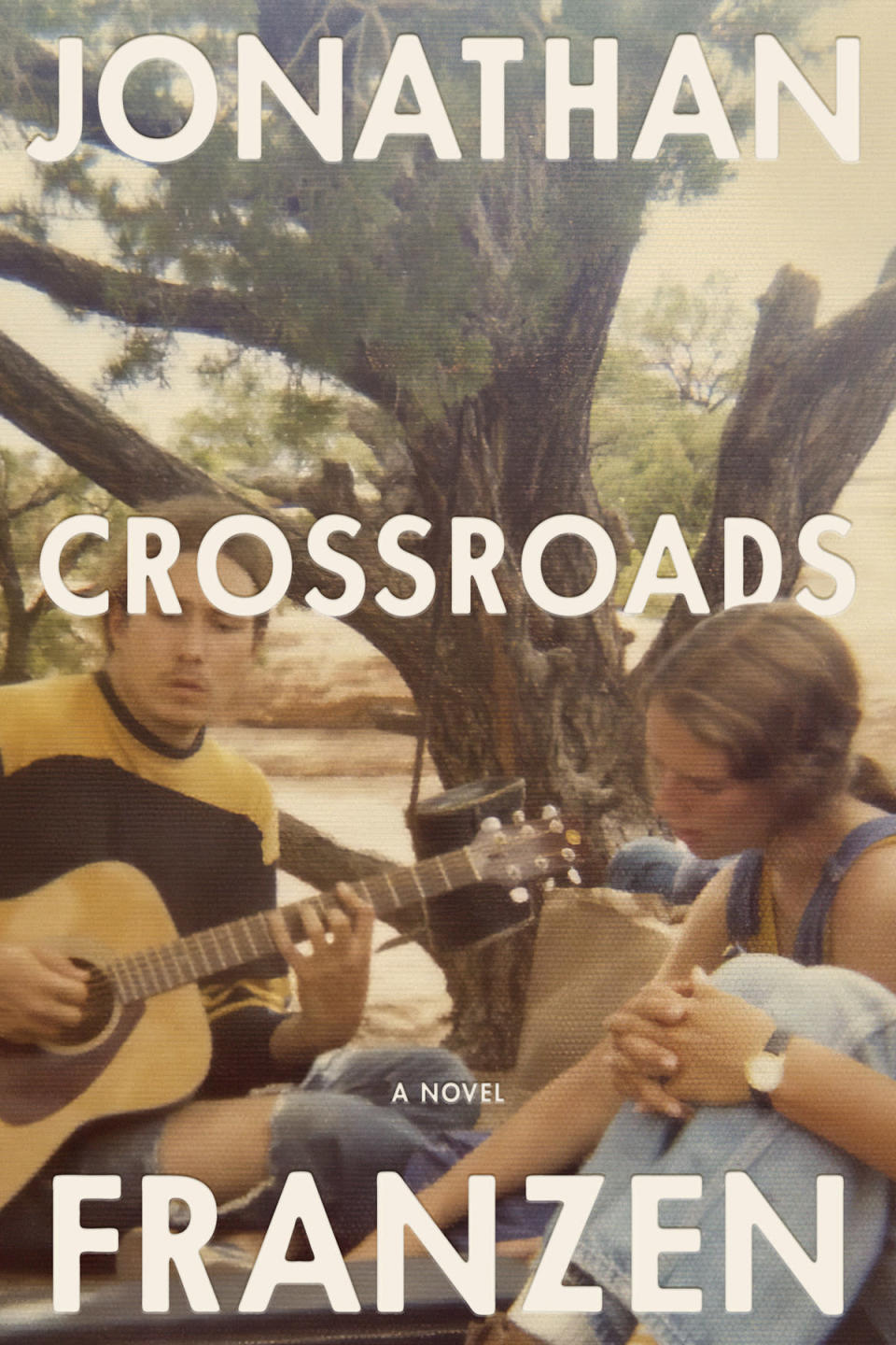 """This cover image released by Farrar, Straus and Giroux shows """"Crossroads,"""" a novel by Jonathan Franzen releasing on Oct. 5. (Farrar, Straus and Giroux via AP)"""