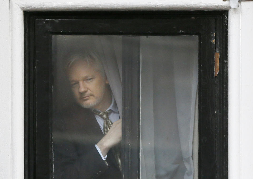 Wikileaks founder Julian Assange appears at the window before speaking on the balcony of the Ecuadorean Embassy in London on Feb. 5, 2016. (Kirsty Wigglesworth/AP)