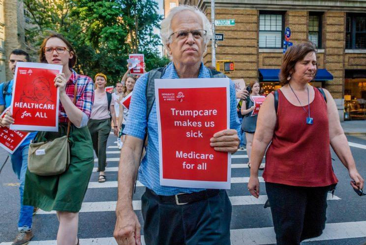 The Socialist Feminists of Democratic Socialists of America (DSA) organized a protest outside of the New York County Republican Office in New York City on July 5, 2017 to tell Republicans that is it despicable and undemocratic that they are trying to ram Trumpcare through the Senate without debate or public hearings.