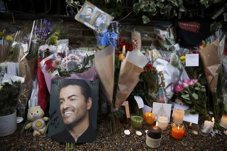FILE PHOTO - Tributes to singer George Michael are displayed outside of his home in north London