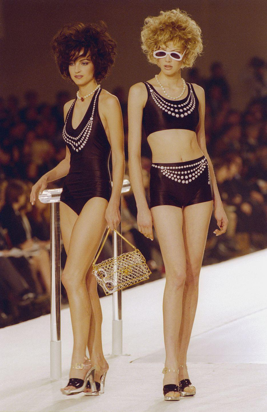 <p>Pearl accents - in faux-necklace form and as rhinestone-like details - were huge circa 1997, as these models show.</p>