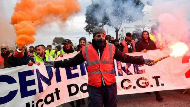 PHOTO: People march as they take part in a demonstration to protest against the pension overhauls, in Marseille, France, Dec. 5, 2019. (Clement Mahoudeau/AFP via Getty Images)