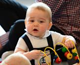 <p>George, 9 months, hams it up while attending a playgroup at Government House in Wellington, New Zealand. The visit was part of George, Kate, and William's official three-week tour of Australia and New Zealand.</p>