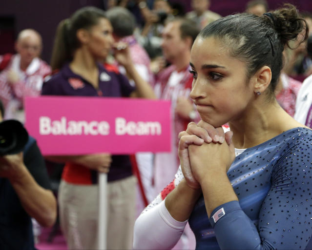 U.S. gymnast Alexandra Raisman waits as results are being reassessed during the artistic gymnastics women's apparatus finals at the 2012 Summer Olympics, Tuesday, Aug. 7, 2012, in London. Raisman won the balance beam bronze after questioning her score when she initially finished fourth. (AP Photo/Gregory Bull)