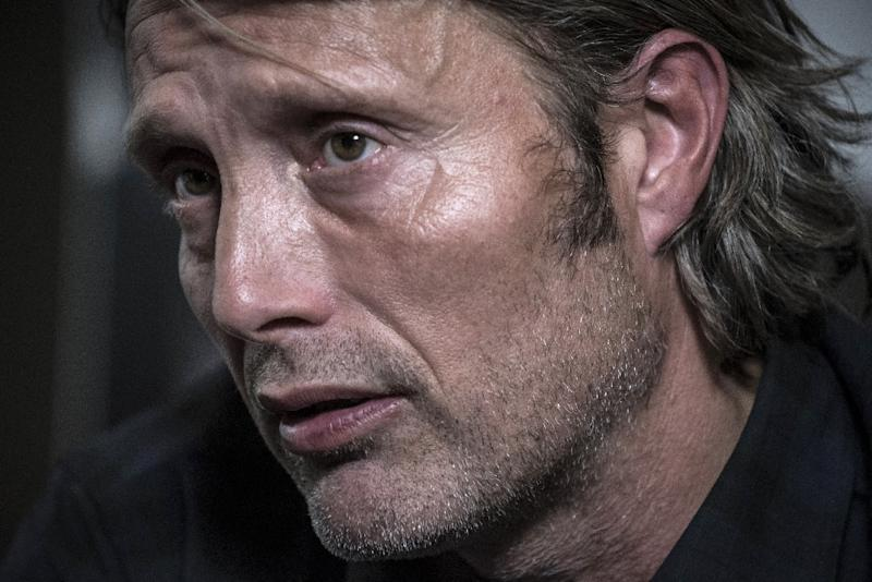 Danish actor Mads Mikkelsen looks on as he gives an interview on October 14, 2015 during the 7th Lumiere Film Festival in Lyon, central France