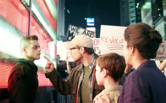 """<p>Often described as the """"Crossroads of the World,"""" Times Square serves as a major crossroads for Elliot (Rami Malek) in <i>Mr. Robot</i>'s freshman season finale. Loosely inspired by <i>V for Vendetta </i>and the opening sequence of the Tom Cruise film, <i><a href=""""https://www.yahoo.com/tv/mr-robot-sam-esmail-dissects-four-finale-128209661760.html?soc_src=mail&soc_trk=ma"""" data-ylk=""""slk:Vanilla Sky;outcm:mb_qualified_link;_E:mb_qualified_link;ct:story;"""" class=""""link rapid-noclick-resp yahoo-link"""">Vanilla Sky</a></i>, Elliot banishes a crowd of masked Fsociety fans from the premises, and then finds himself alone in Times Square… alone, that is, except for his """"ghost dad,"""" Mr. Robot (Christian Slater), who appears on a Jumbotron screen overhead. In that moment fantasy and reality blurred so completely, it almost made Times Square seem appealing. — <i>EA</i></p><p><i>(Credit: NBC)</i></p>"""