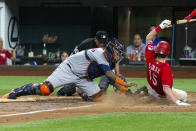 Texas Rangers' Nick Solak (15) slides into home plate ahead of a tag by Houston Astros catcher Martin Maldonado, left, during the sixth inning of a baseball game, Friday, Aug. 27, 2021, in Arlington, Texas. (AP Photo/Sam Hodde)