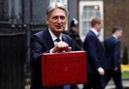 Britain's Chancellor of the Exchequer Philip Hammond stands outside 11 Downing Street before delivering his budget to the House of Commons in London