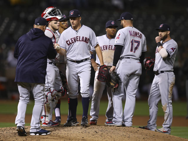 Cleveland Indians pitcher Trevor Bauer hands the ball to manager Terry Francona during the seventh inning of the team's baseball game against the Oakland Athletics on Friday, June 29, 2018, in Oakland, Calif. (AP Photo/Ben Margot)