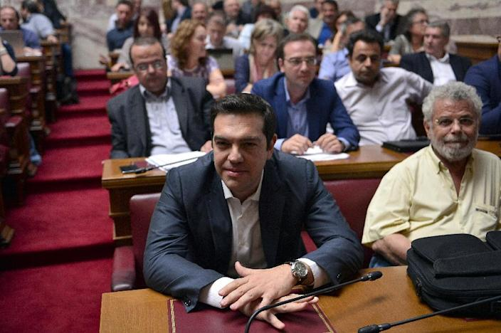Greek Prime Minister Alexis Tsipras attends his Syriza party's parliamentary group meeting at the parliament in Athens on July 15, 2015 (AFP Photo/Louisa Gouliamaki)