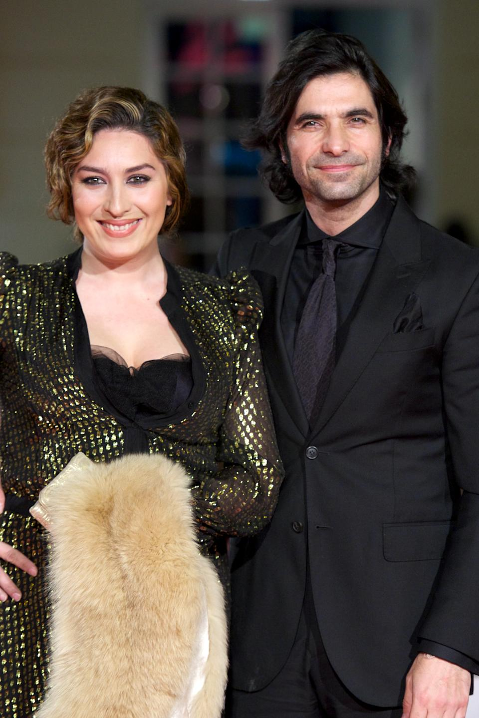 """MALAGA, SPAIN - MARCH 25:  Spanish singer Estrella Morente and Javier Conde attend the """"Dioses y Perros"""" premiere during the 17th Malaga Film Festival 2014 - Day 5 at the Cervantes Theater on March 25, 2014 in Malaga, Spain.  (Photo by Carlos Alvarez/Getty Images)"""
