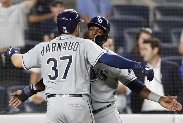 Tampa Bay Rays' Travis d'Arnaud, left, celebrates with Guillermo Heredia after hitting a ninth-inning go-ahead three-run home run in a baseball game against the New York Yankees, Monday, July 15, 2019, in New York. (AP Photo/Kathy Willens)