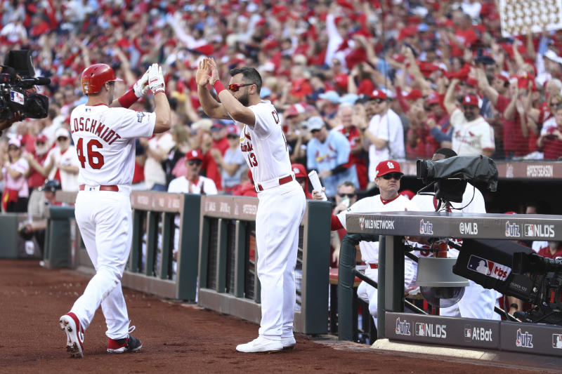 St. Louis Cardinals' Paul Goldschmidt (46) celebrates with Matt Carpenter (13) after hitting a solo home run during the first inning in Game 4 of a baseball National League Division Series against the Atlanta Braves, Monday, Oct. 7, 2019, in St. Louis. (Jamie Squire/Getty via AP, Pool)