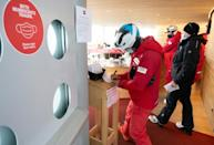 Skiers had to fill out forms to enter a cafe at the Pitztal glacier in Austria as part of Covid-19 safety measures