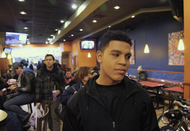 Baresco Escobar, 19, from Fairfax, Va., an aspiring entertainer who identifies himself as bisexual, visits a local fast food hangout in Manhattan's Union Square popular with youth from the LGBT - lesbian, gay, bisexual or transgender  community, Thursday, March 1, 2012, in New York.  When he leaves in the late evening, Escobar goes to the far end of Brooklyn to sleep in an abandoned house with dozens of other homeless kids, covering bare floors with blankets and cuddling for warmth. (AP Photo/Bebeto Matthews)