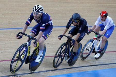 Cycling - UCI Track World Championships - Men's Omnium, Points Race - Hong Kong, China – 15/4/17 - France's Benjamin Thomas competes with New Zealand's Aaron Gate and Italy's Simone Consonni. REUTERS/Bobby Yip