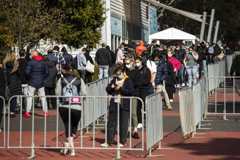 People line up outside the COVID vaccination hub at the Royal Melbourne Showgrounds in Melbourne. Source: AAP