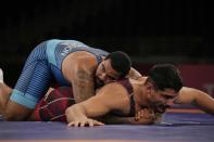 United States' Gable Dan Steveson compete with Turkey's Taha Akgul during the men's 125kg Freestyle wrestling quarterfinal match at the 2020 Summer Olympics, Thursday, Aug. 5, 2021, in Tokyo, Japan. (AP Photo/Aaron Favila)