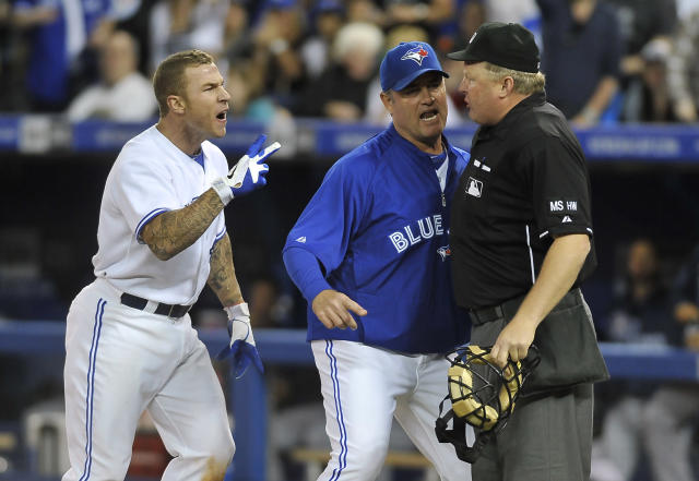 TORONTO, CANADA - MAY 15: Brett Lawrie #13 and Manager John Farrell of the Toronto Blue Jays argue a call with Umpire Bill Miller during MLB game action against the Tampa Bay Rays May 15, 2012 at Rogers Centre in Toronto, Ontario, Canada. (Photo by Brad White/Getty Images)