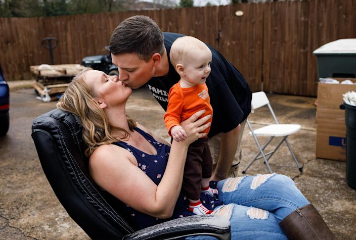 Matt Colvin with his wife, Brittany, and son, Logan, at their home in Hixson, Tenn., March 12, 2020. (Doug Strickland/The New York Times)