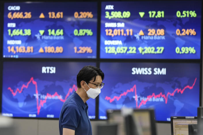 A currency trader watches monitors at the foreign exchange dealing room of the KEB Hana Bank headquarters in Seoul, South Korea, Friday, June 18, 2021. Asian shares mostly rose Friday, as investors digested the latest message from the U.S. Federal Reserve on raising short-term interest rates by late 2023. (AP Photo/Ahn Young-joon)