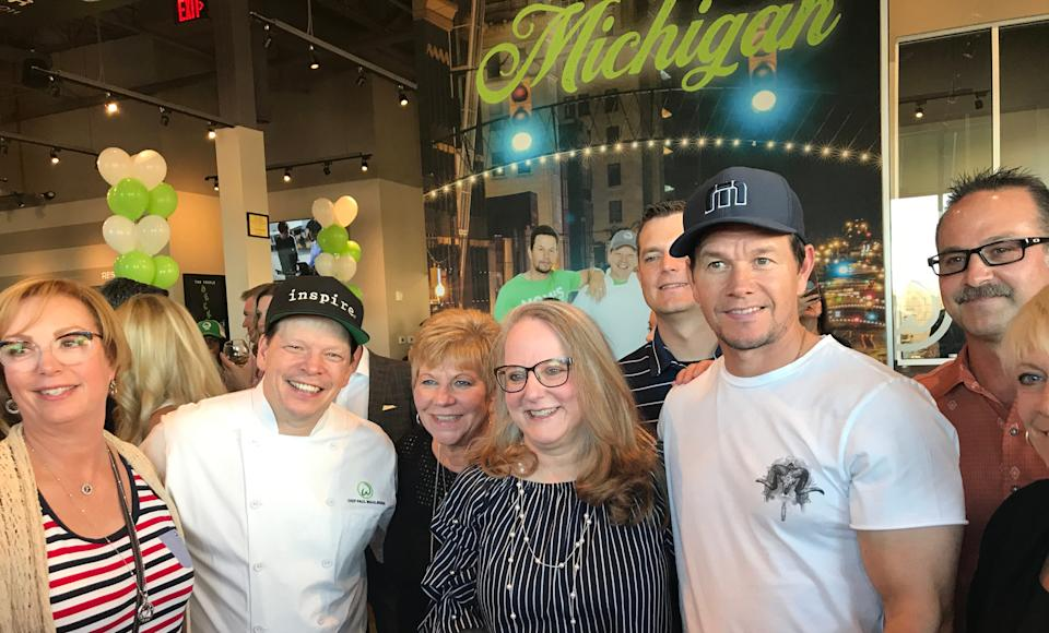(From left) Chef Paul Wahlberg and Mark Wahlberg celebrated the grand opening of the Flint Wahlburgers in July 2019.   Jay Feldman is a partner in the restaurant.