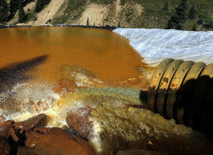 Water flows through a series of retention ponds built to contain and filter out heavy metals and chemicals from the Gold King mine chemical accident, in the spillway about a quarter-mile downstream from the mine, outside Silverton, Colo., in August 2015. (Photo: Brennan Linsley/AP)