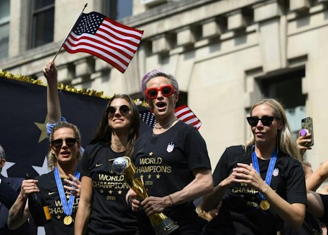 In this photo taken on July 10, 2019 Megan Rapinoe (C) and other members of the World Cup-winning US women's team take part in a ticker tape parade in New York (AFP Photo/Johannes EISELE)