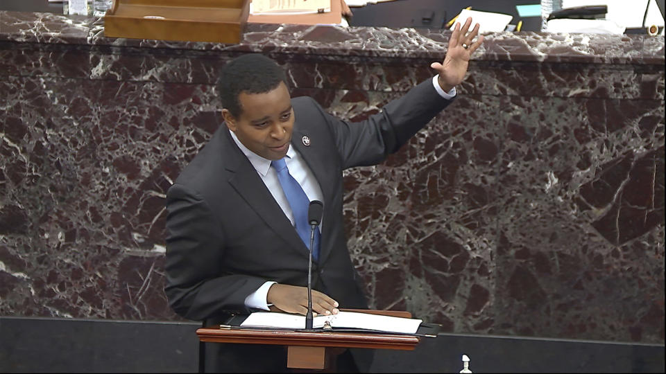 In this image from video, House impeachment manager Rep. Joe Neguse, D-Colo., speaks during the second impeachment trial of former President Donald Trump in the Senate at the U.S. Capitol in Washington, Tuesday, Feb. 9, 2021. (Senate Television via AP)