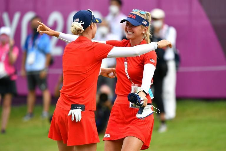 Nelly Korda (left) celebrates her Olympic gold medal victory with sister Jessica last month. (AFP/Kazuhiro NOGI)
