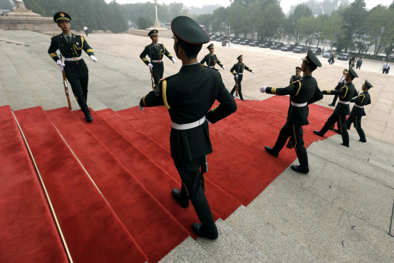 Chinese soldiers prepare for the arrival of German Chancellor Angela Merkel outside the Great Hall of the People in Beijing Thursday, Aug. 30, 2012. (AP Photo/Ng Han Guan)