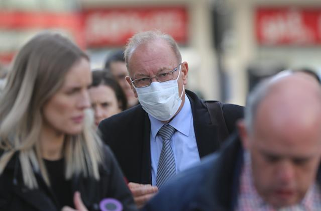 A man wears a medical mask as a precaution against coronavirus in central London. (Getty Images)