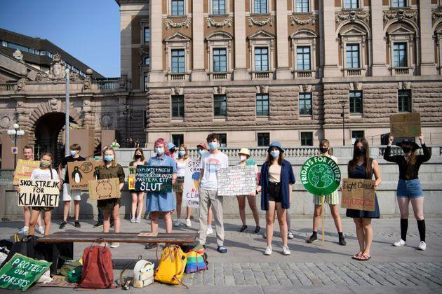 Swedish climate activist Greta Thunberg (2ndL) and other climate protesters gather for a protest against climate change in front of the Swedish parliament building in Stockholm, Sweden, on June 18, 2021. - - Sweden OUT (Photo by Henrik MONTGOMERY / TT NEWS AGENCY / AFP) / Sweden OUT (Photo by HENRIK MONTGOMERY/TT NEWS AGENCY/AFP via Getty Images) (Photo: HENRIK MONTGOMERY via Getty Images)