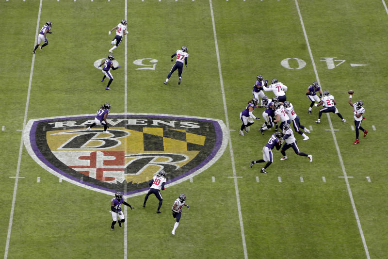 Houston Texans quarterback Deshaun Watson, far right, throws a pass to wide receiver DeAndre Hopkins (10) during the first half of an NFL football game against the Baltimore Ravens, Sunday, Nov. 17, 2019, in Baltimore. (AP Photo/Julio Cortez)
