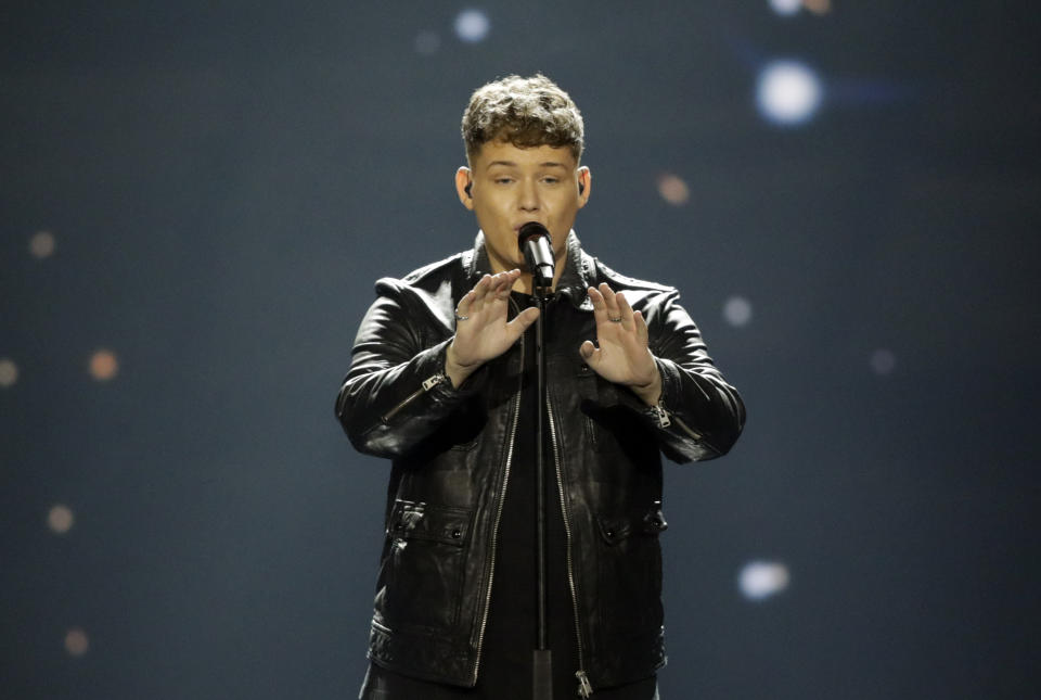 """Michael Rice of Great Britain performs the song """"Bigger Than Us"""" during the 2019 Eurovision Song Contest grand final rehearsal in Tel Aviv, Israel, Friday, May 17, 2019. (AP Photo/Sebastian Scheiner)"""
